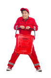 Man in red coveralls with shopping supermarket. Cart trolley Stock Image