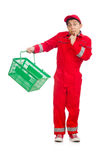 Man in red coveralls with shopping supermarket. Cart trolley Royalty Free Stock Image