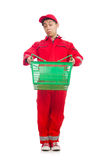 Man in red coveralls with shopping supermarket. Cart trolley Royalty Free Stock Photo