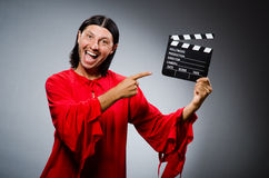 Man in red dress with movie Royalty Free Stock Photo