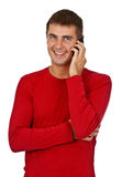 Man in a red dress speaks on a mobile phone. Royalty Free Stock Photo