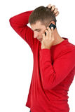 Man in a red dress speaks on a mobile phone. Stock Photos