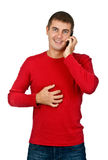 Man in a red dress speaks on a mobile phone. Stock Images