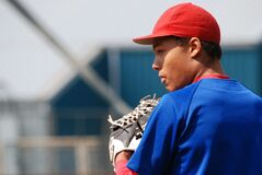 Man in Red Fitted Cap Wearing Blue Shirt With White Leather Baseball Mitt on Hand during Daytime stock photography