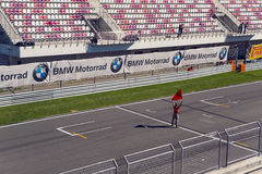 Man with a red flag on the Moto track before the race Stock Photo