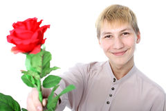 Man with red flower Stock Photo