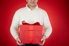 Man with red giftbox Stock Photos