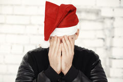 Man with red hat celebrating Christmas eve Stock Photo