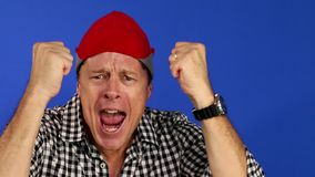 Man celebrating the victory of his soccer team or his company. Man with red hat, celebrating the victory of his soccer team or his company stock footage