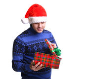 Man in red hat with gift Royalty Free Stock Photo