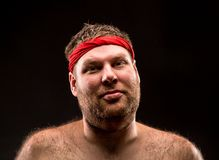 Man with red headband Stock Images