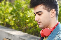 Man with red headphones. Royalty Free Stock Photo