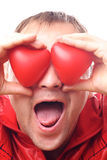 Man with red heart-shapes Stock Photo