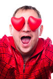 Man with red heart-shapes Stock Photography