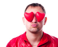 Man with red heart-shapes Royalty Free Stock Photography