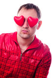 Man with red heart-shapes Stock Image