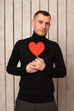Man with red heart Stock Photos