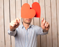 Man with red heart Stock Image