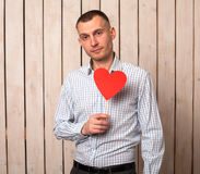 Man with red heart Stock Images