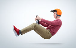 Man in red helmet car driver with steering wheel, auto concept Stock Images