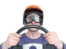 Man in red helmet and goggles with steering wheel, isolated on white background. car driver concept.  Stock Image