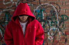 A man in a red jacket on the street royalty free stock photos