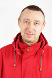 Man in a red jacket Stock Images