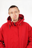 Man in a red jacket with a cigarette Stock Image