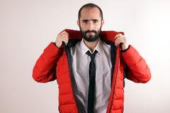 Man with red jacket Stock Images