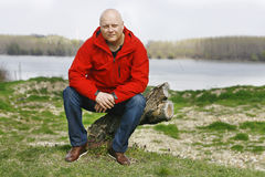 Man In A Red Jacket Sitting On Tree Nature Royalty Free Stock Photography