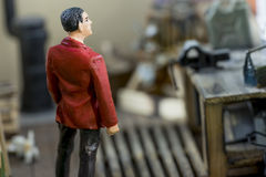Man with a red jacket standing in a model lodge. With blurry background Stock Photography