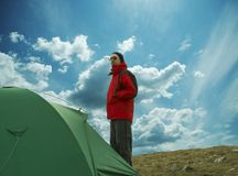 Man in red jacket about tent Stock Photo