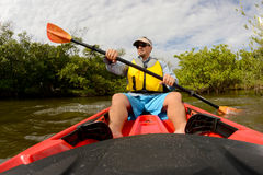 Man in red kayak Stock Photos