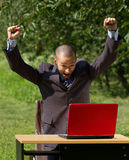 Man with red laptop working outdoors Royalty Free Stock Images