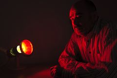 Man with red light Stock Photo