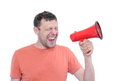 Man with red megaphone on white background Stock Photo