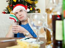 Man in red New Year  hat  stuping  towel to head Royalty Free Stock Images