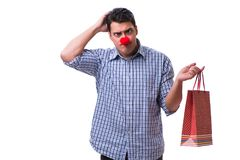 Man with a red nose funny holding a shopping bag gift present is Stock Photo