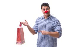 Man with a red nose funny holding a shopping bag gift present is Royalty Free Stock Photos