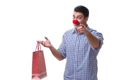 Man with a red nose funny holding a shopping bag gift present is Royalty Free Stock Photography