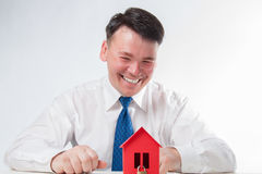 Man with a red paper house Stock Photos