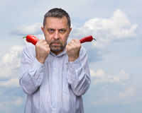 A man with a red pepper Stock Photography