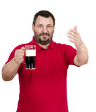 Bartender in red polo invites you to drink ale. White bearded bartender in red polo shirt invites you to drink ale Stock Photos