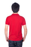 Man in red polo shirt isolated on white background back side. Man in red polo shirt isolated on a white background back side Royalty Free Stock Photo