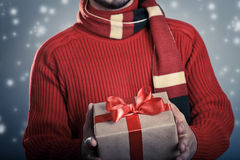Man with red ribbon gift box. Male giving a red ribbon gift box. Holiday concept Stock Image