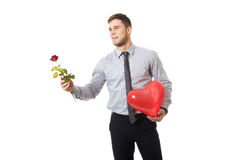 Man with red rose and heart balloon. Royalty Free Stock Photography