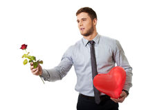 Man with red rose and heart balloon. Stock Images