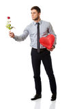 Man with red rose and heart balloon. Stock Photos