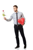 Man with red rose and heart balloon. Royalty Free Stock Photos