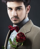 Man with a red rose Stock Images